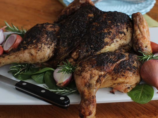 A roasted spatchcocked chicken is seasoned with a blend of coffee, cayenne and cumin. Spatchcocking a chicken, also called butterflying, can reduce roasting time almost by half.