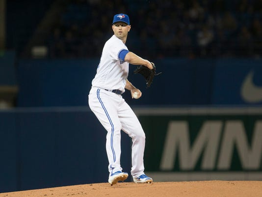 Toronto Blue Jays' starting pitcher J.A. Happ works against the Tampa Bay Rays during the first inning of a baseball game in Toronto, Monday, May 16, 2016. (Chris Young/The Canadian Press via AP)