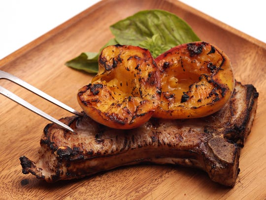 Grilled peaches go perfectly with a grilled pork chop. as seen in Phoenix on May 6, 2015