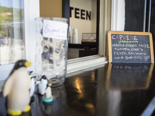 Kitsch and a chalkboard special of the day adorn the counter at Canteen Creemee Company in Waitsfield. Charlie Menard, longtime chef at Inn at the Round Barn, recently opened the creemee stand on Vermont 100.