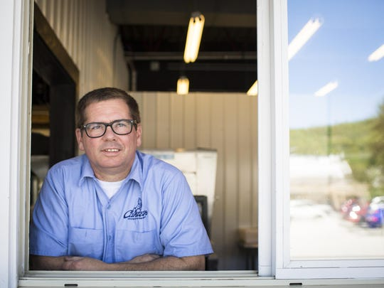 Chef and Canteen Creemee Company founder Charlie Menard poses for a portrait in the window of the Waitsfield snack shack on Thursday, June 23, 2016. Menard, a longtime chef at Inn at the Round Barn, recently opened the creemee and snack stand on Vermont 100.