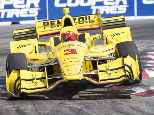 Helio Castroneves takes a turn in a Verizon IndyCar Series race on July 17 in Toronto. He finished runner-up to Penske teammate Will Power.
