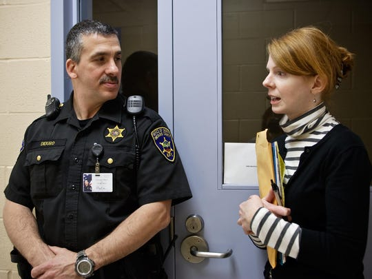 Filmmaker Linda Moroney and Officer Vincent J. Diruro at the Ontario County Jail while filming Turn the Page.