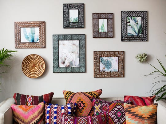Wooden handmade frames by New Orleans-based Alyse studio owner Alyse Rodriguez, who makes artistic wooden picture frames and rustic home decor.