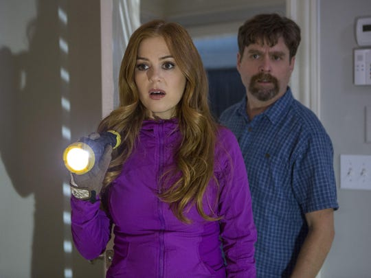 """Isla Fisher, left, and Zach Galifianakis star in """"Keeping Up With The Joneses."""""""