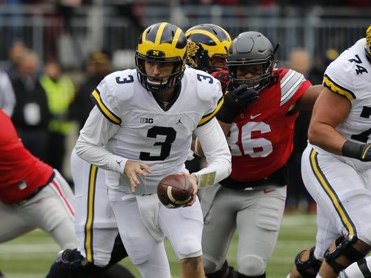 Michigan quarterback Wilton Speight plays against Ohio State in an NCAA college football game Saturday, Nov. 26, 2016, in Columbus, Ohio. (AP Photo/Jay LaPrete)