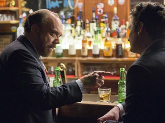 Paul Giamatti as Chuck Rhoades and Toby Leonard Moore