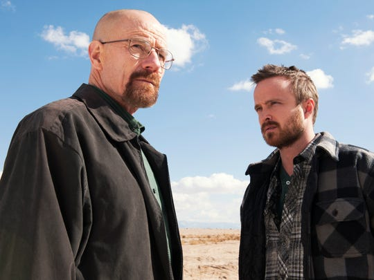 """This image released by AMC shows Bryan Cranston as Walter White, left, and Aaron Paul as Jesse Pinkman in a scene from """"Breaking Bad."""" The Nielsen company, for the first time this season, is measuring how many people are reading Twitter messages about particular TV programs the night they are on the air. Nielsen said Monday, June 2, 2014, that the drug-dealing drama starring Bryan Cranston had an average of 6 million people seeing tweets for each episode. The show was boosted by its finale last September, where the number shot up to 9.1 million. (AP Photo/AMC, Frank Ockenfels ) ORG XMIT: NYET156"""