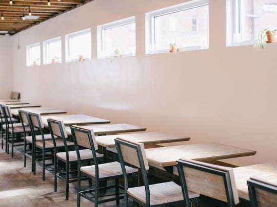 At Midtown Eats, a banquette runs the length of the dining room filled with natural light.