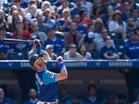 Toronto Blue Jays' Josh Donaldson hits a RBI double against the Minnesota Twins during eighth inning American League MLB baseball action in Toronto on Saturday, Aug. 26 2017. (Chris Young/The Canadian Press via AP)