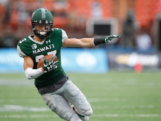 Hawaii wide receiver Dylan Collie makes a catch over Western Carolina during the first quarter of the NCAA college football game, Saturday, Sept. 2, 2017, in Honolulu. (AP Photo/Marco Garcia)