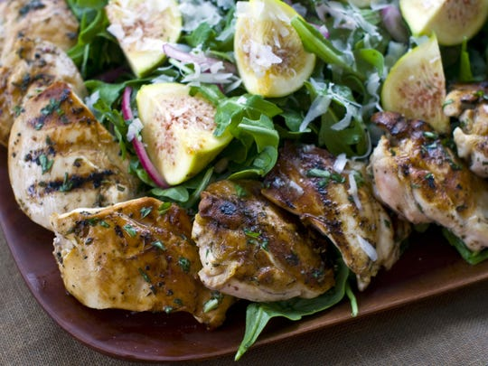 The union of grilled chicken thighs and figs might seem jarring, but the pairing works, the rich peppery grilled flavor and sweetness of the figs balancing each other. Matthew Mead/AP