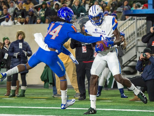 Colorado State receiver Michael Gallup pulls in a pass for a touchdown as Boise State cornerback Tyler Horton defends during the first quarter of an NCAA college football game Saturday, Nov. 11, 2017, in Fort Collins, Colo. (Timothy Hurst/The Coloradoan via AP)