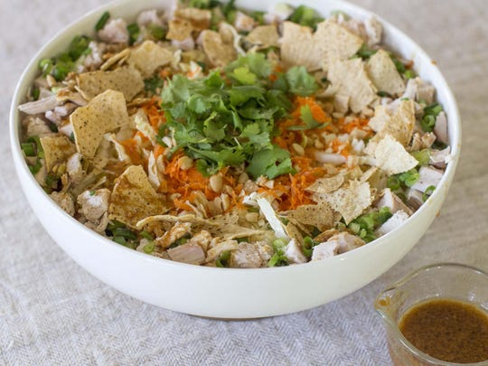 Leftover holiday turkey becomes a meal-size salad spiked with ginger lime vinaigrette.