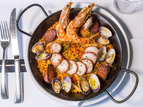 LuLou's delivers a twist on paella with Serrano-wrapped rabbit, chorizo, clams, shrimp and gypsy peppers.