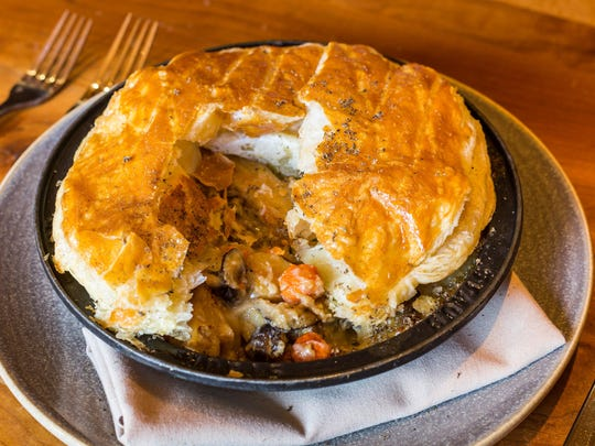 At Manzanita in the Ritz-Carlton Lake Tahoe, a luxurious twist on pot pie with roasted chicken, root vegetables, sherry mushroom velouté and a shave of Burgundy black truffle.