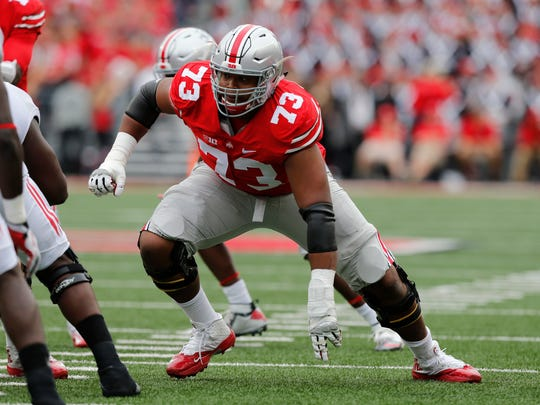 FILE - In this Oct. 1, 2016, file photo, Ohio State offensive lineman Michael Jordan plays against Rutgers during an NCAA college football game in Columbus, Ohio. Jordan was selected to the 2017 AP All-Conference Big Ten team announced Wednesday, Dec. 6, 2017. (AP Photo/Jay LaPrete, File)