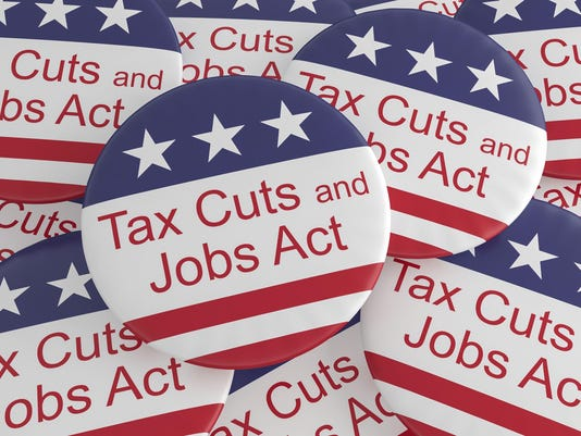 USA Politics News Badges Pile of Tax Cuts And Jobs Act Buttons With US Flag 3d i