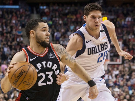 Toronto Raptors guard Fred VanVleet (23) drives past Dallas Mavericks forward Doug McDermott (20) during first half NBA basketball action in Toronto on Friday March 16, 2018.(Chris Young/The Canadian Press via AP)