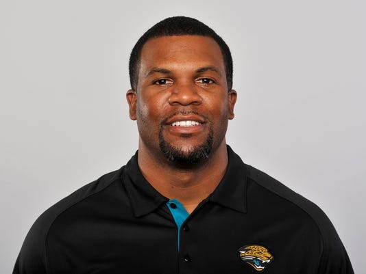 FILE - This is a 2012 file photo of Marlon McCree of the Jacksonville Jaguars NFL football team. Authorities say the former Jaguars safety and assistant coach was arrested Saturday, April 7, 2018, following a vehicle chase with his ex-wife and crashing his truck into her SUV.  A Jacksonville Sheriff's Office report says the 41-year-old McCree was arrested on charges of simple assault and aggravated battery. (AP Photo/File)