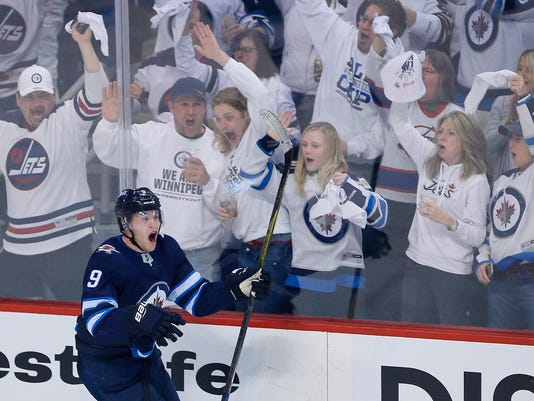 Winnipeg Jets' Andrew Copp (9) celebrates his goal against the Minnesota Wild during the third period of Game 2 of an NHL hockey first-round playoff series Friday, April 13, 2018, in Winnipeg, Manitoba. (John Woods/The Canadian Press)