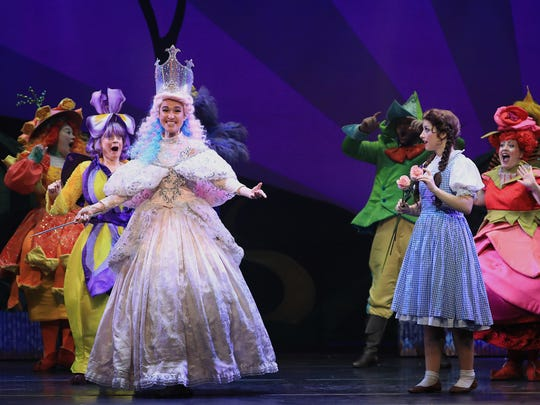 "Glinda the Good Witch (Katherine Walker Hill) meets Dorothy Gale (Kalie Kaimann) in the national tour of ""The Wizard of Oz."""