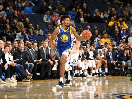OAKLAND, CA - NOVEMBER 10: Jacob Evans #10 of the Golden State Warriors handles the ball against the Brooklyn Nets on November 10, 2018 at ORACLE Arena in Oakland, California. NOTE TO USER: User expressly acknowledges and agrees that, by downloading and or using this photograph, User is consenting to the terms and conditions of the Getty Images License Agreement. Mandatory Copyright Notice: Copyright 2018 NBAE (Photo by Noah Graham/NBAE via Getty Images)