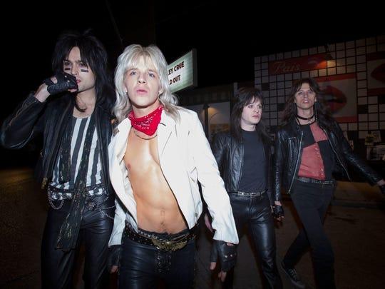 "Motley Crue bandmates Nikki Sixx (Douglas Booth, left), Vince Neil (Daniel Webber), Mick Mars (Iwan Rheon) and Tommy Lee (Colson Baker) own the L.A. rock scene in ""The Dirt."""