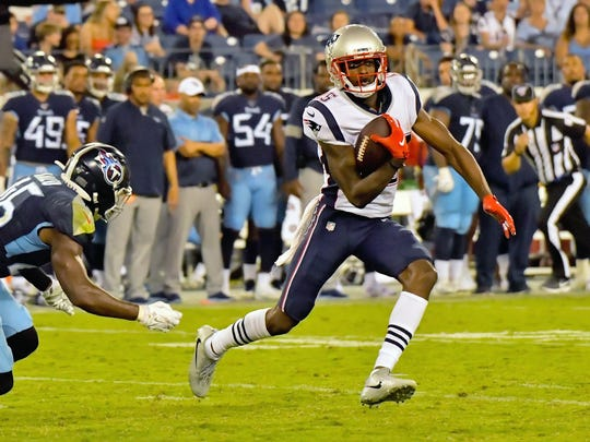 Dontrelle Inman runs with the ball against the Titans on Saturday.