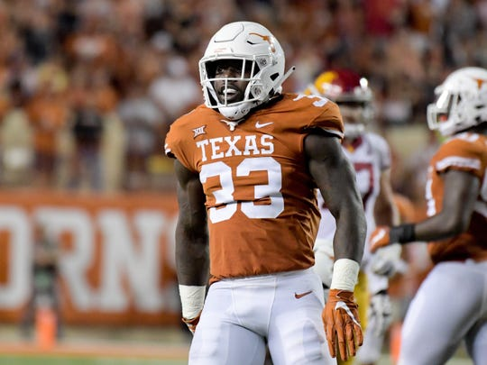 Sep 15, 2018; Austin, TX, USA; Texas Longhorns linebacker Gary Johnson (33) reacts during the second half against the Southern California Trojans at Darrell K Royal-Texas Memorial Stadium. Mandatory Credit: Kirby Lee-USA TODAY Sports