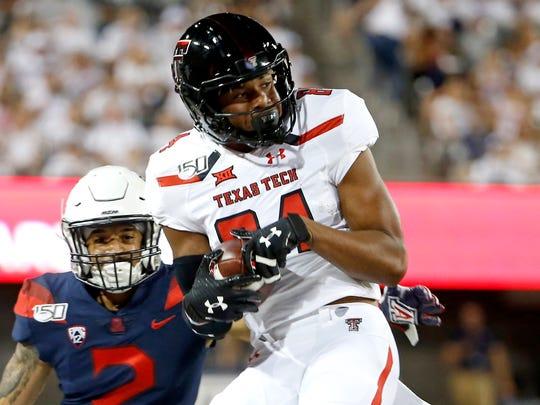 Texas Tech wide receiver Erik Ezukanma (84) catches the ball in front of Arizona cornerback Lorenzo Burns (2) during the first half of an NCAA college football game, Saturday, Sept. 14, 2019, in Tucson, Ariz. (AP Photo/Ralph Freso)
