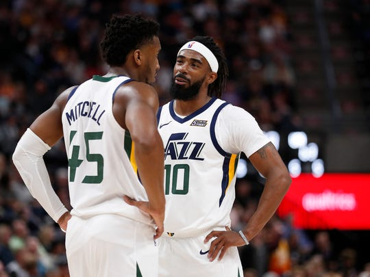 Utah Jazz guard Mike Conley with teammate Donovan Mitchell.
