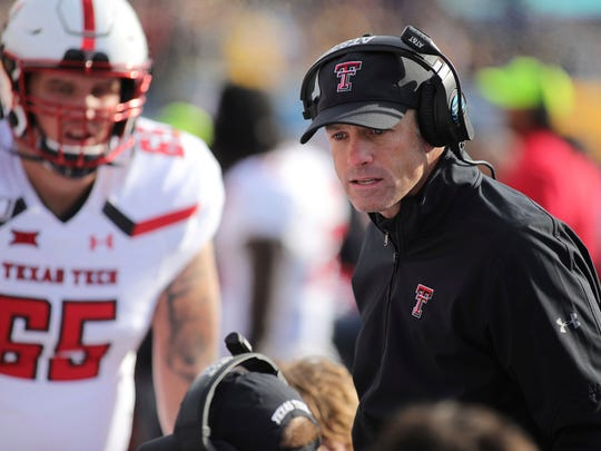 Texas Tech head coach Matt Wells speaks to his team during the third quarter of their NCAA college football game against West Virginia in Morgantown, W.Va., Saturday, Nov. 9, 2019. (AP Photo/Chris Jackson)