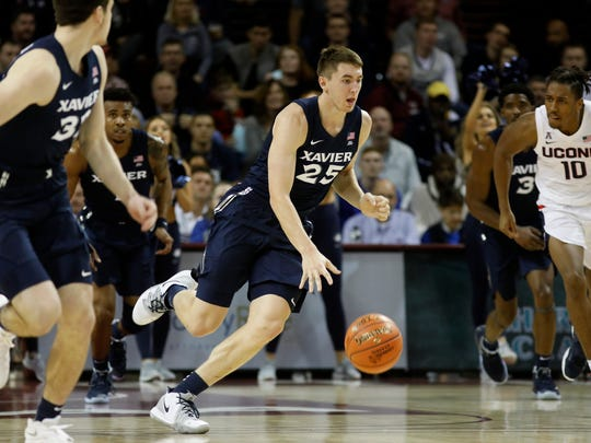 Xavier's Jason Carter drives the ball up the court against the defense of Connecticut in the first half of an NCAA college basketball game during the Charleston Classic Friday, Nov. 22, 2019, in Charleston, SC. (AP Photo/Mic Smith)