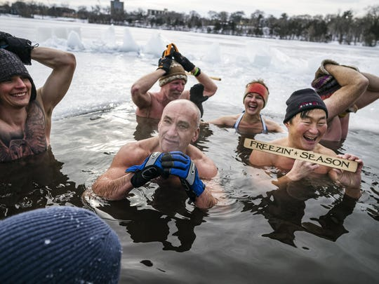 Throughout the winter, biohackers maintain a hole in the ice chopped into Cedar Lake in Minneapolis in the belief that regular cold water immersions make them healthier.