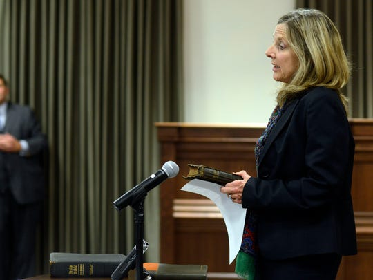 Buncombe County Commissioner Ellen Frost addresses the crowd after being sworn in this Citizen Times file photo. She was federally indicted July 16, 2019, with prosecutors alleging she and former manager Wanda Greene conspired to use county funds for equestrian sponsorships and promotions that brought personal benefits.