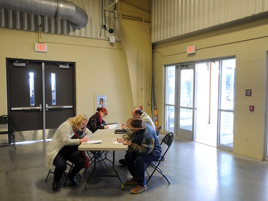 Hundreds flooded the the Davis Event Center at the WNC Agricultural Center in Fletcher Wednesday for the ninth annual Asheville Area Chamber of Commerce job fair. A record number of employers, about 100 total, attended the event looking to fill roughly 6,000 jobs.