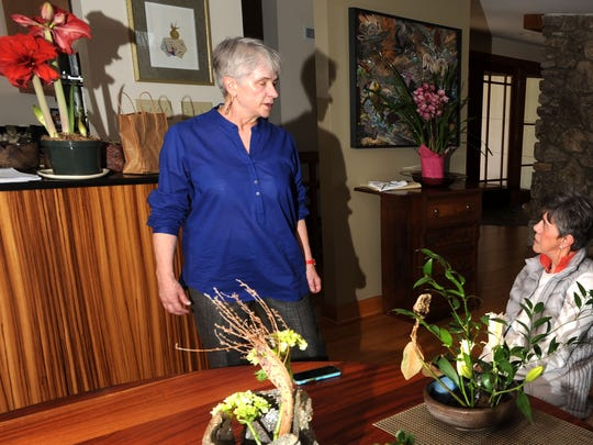 Asheville resident, Ikebana master and teacher Elizabeth Campbell talks with student Birch Carlson following a lesson at her home in Asheville last week.
