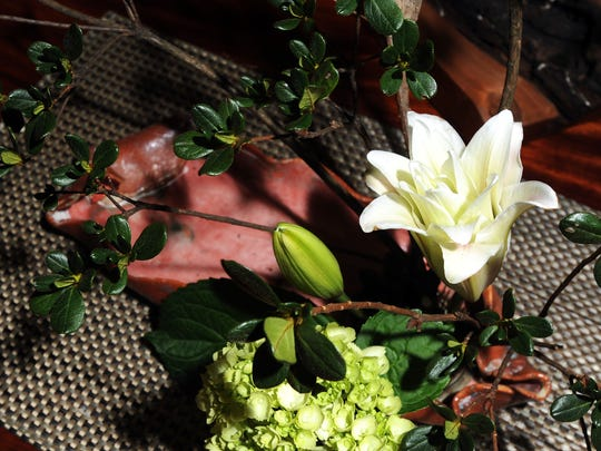 Asheville resident MaryJane Findley's floral arrangement known as Ikebana, the Japanese art of flower arrangement, sits on the table of Ikebana master and teacher Elizabeth Campbell at her home in Asheville Tuesday afternoon Jan. 20, 2015.