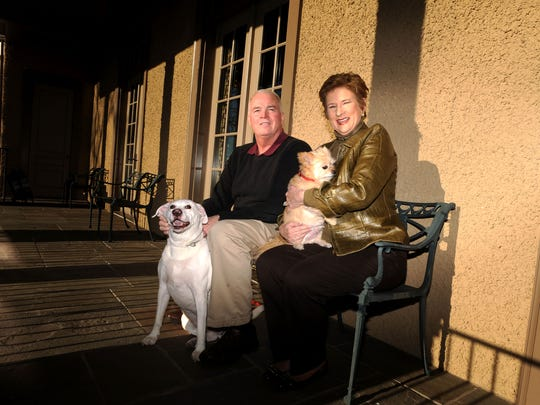 Joe and Janice Brumit sit with their dogs Kipper and Ernie in 2015 at their home in Asheville.