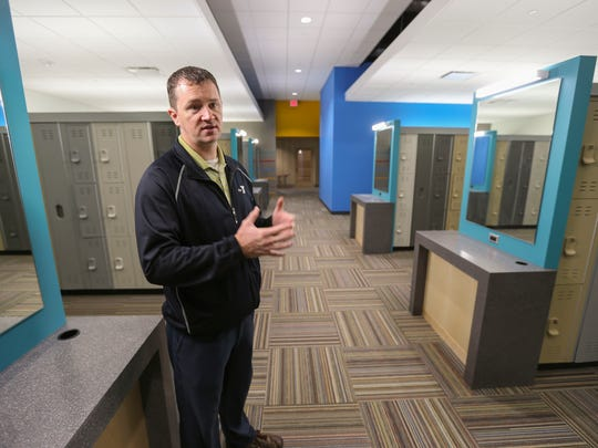 Tim Short, executive director of the YMCA in downtown Des Moines, shows the men's fitness center locker room during a tour of the new Wellmark YMCA. The room will have workout equipment in it, as well as a whirlpool, a wet sauna, a dry sauna and laundry service.