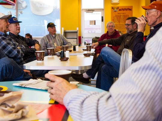 Terry Reistad, Dave Warneke, John Ranum, Jim Carlson, Del Johnson, Bill Salonen and Rich Wilson (left to right) are part of an informal group of retired Great Falls men who meet Monday through Friday at McDonald's to discuss current events over coffee. Not pictured: Carl Christofferson, Dave Hickman.