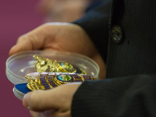 Officer Jon Marshall looks down at his new GFPD badge shortly after being sworn in Wednesday morning.
