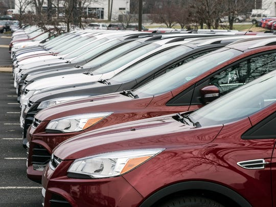A line of Ford Escape SUV's, built in Louisville, seem to stretch to the horizon at Bill Collins Ford at Bardstown Road and Fegenbush Lane. Sales of the vehicle have been strong, placing it on the list of best selling SUV's.