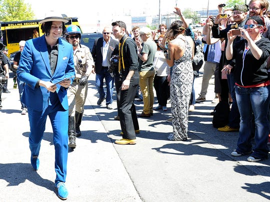Jack White delivers the first batch of the Worlds Fastest records to fans in front of Third Man Records Saturday, April 19, 2014 in Nashville, Tenn. White and his band recorded the record live Saturday morning and had records pressed within hours, setting a world record on Record Store Day.