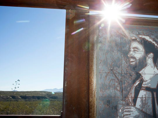 An image of a smiling Gabe Zimmerman stands at the entrance of a trailhead near Tucson that has been renamed in his honor. Gabe was one of six people who died in a shooting four years ago that targeted then-Rep. Gabrielle Giffords.