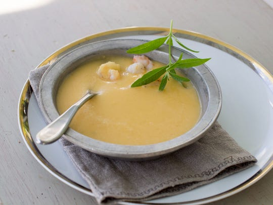 Coconut butternut squash soup with shrimp is a warm treat.