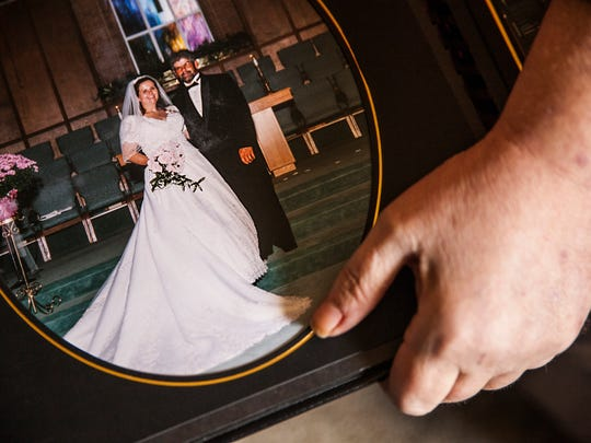 Patricia Dean, who has been disciplined multiple times by the Virginia Board of Nursing, holds the wedding portrait of her and her late husband on Thursday, Oct. 16, 2014.