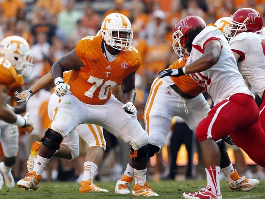 FILE - In this Aug. 31, 2013, file photo, Tennessee's Ja'Wuan James (70) blocks during the first quarter of an NCAA college football game against Austin Peay in Knoxville, Tenn. James was selected in the first round, 19th overall, by the Miami Dolphins in the NFL draft on Thursday, May 8, 2014. (AP Photo/Wade Payne, File)
