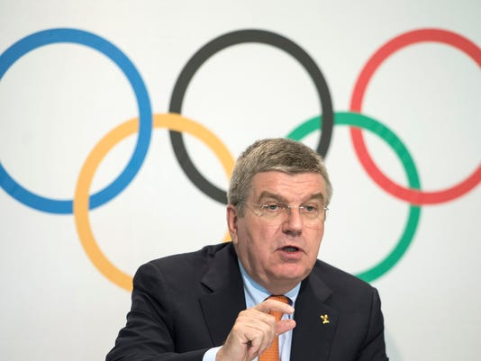 """FILE - In this Wednesday July 9, 2014 file photo, International Olympic Committee (IOC) President Thomas Bach speaks during a press conference after an executive board meeting at the IOC headquarters in Lausanne, Switzerland. IOC President Thomas Bach will receive a total of 225,000 euros ($242,000) a year in compensation to cover the costs related to his job of leading the Olympic body. The figure was disclosed Thursday April 2, 2015, as the International Olympic Committee released its """"indemnity policy"""" covering the allowances and per diems for Bach and other members. (AP Photo/Keystone, Jean-Christophe Bott, File)"""